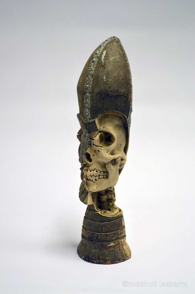 Maskull Lasserre carves skeletons in tchotchkes.